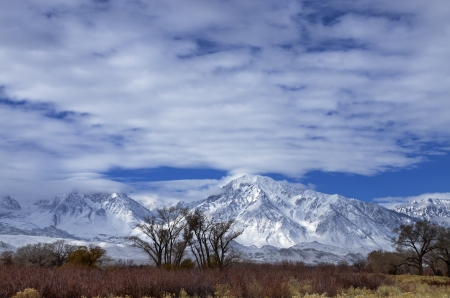 snowy Eastern Sierra mountains from Bishop California including mount Tom and Basin Mountain Stock Photo - 24317105