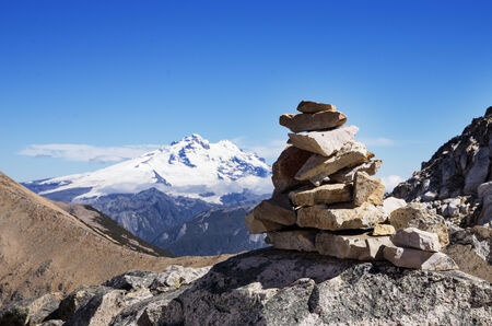 rock cairn and Mount Tronador in the mountains near Bariloche Argentina Stock Photo - 24878874