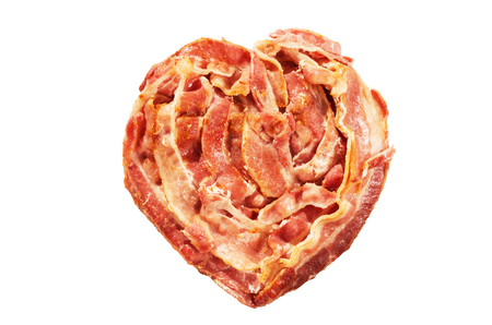 bacon art: cooked bacon heart shape isolated on white background Stock Photo