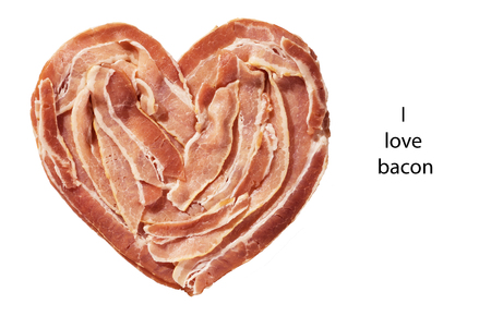 bacon love: raw bacon heart isolated on a white background