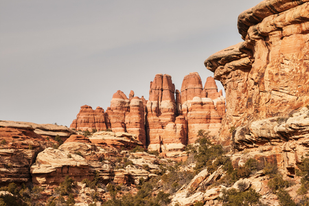 erode: sandstone formations with towers and cliffs in Canyonlands National Park in Utah