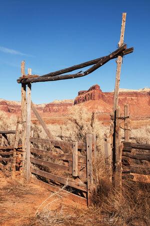 indian creek: vertical image of old western ranch gate in Indian Creek Utah