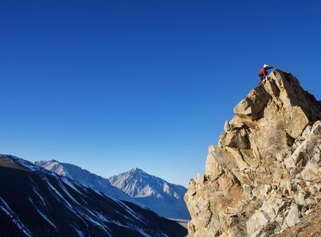 outdoorsman: a man reaches his goal of a mountain top Stock Photo