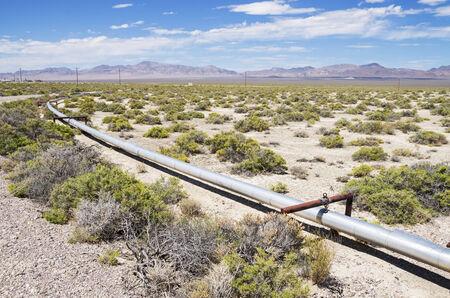 small oil pipeline in the desert in New Mexico Stock Photo