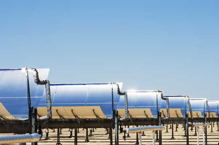 concentrating: solar thermal electric generating plant collection mirrors with blue sky