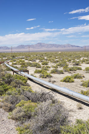 small oil pipeline in a well field in New Mexico photo