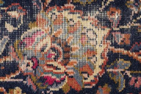 threadbare: threadbare old persian carpet background detail Stock Photo