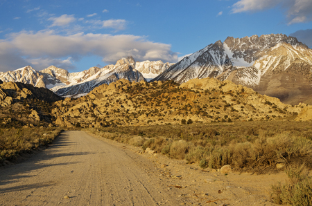 mount humphreys: the Buttermilk dirt road heads towards the mountains of the Eastern Sierra Nevada in California early in the morning Stock Photo