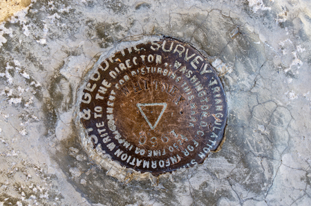 contiguous: Mount Whitney summit benchmark on top of the highest peak in the contiguous 48 states Stock Photo