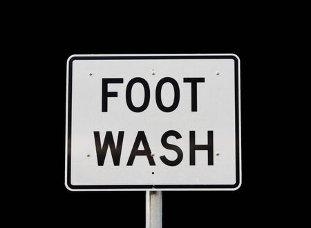 large reflective road sign style foot wash sign isolated on white
