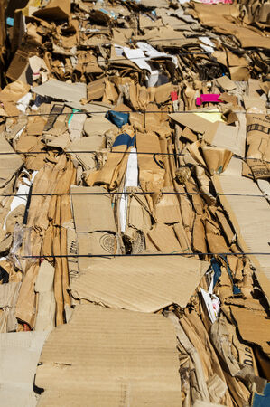 old cardboard boxes pressed into bales for recycling Фото со стока