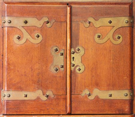 Antique Wood Cabinet Doors With Brass Hinges And Lock Stock Photo, Picture  And Royalty Free Image. Image 29985838. - Antique Wood Cabinet Doors With Brass Hinges And Lock Stock Photo