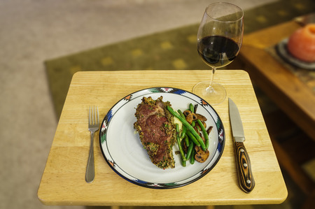 steak dinner with green beans mashed potatoes and mushrooms and a glass of wine photo