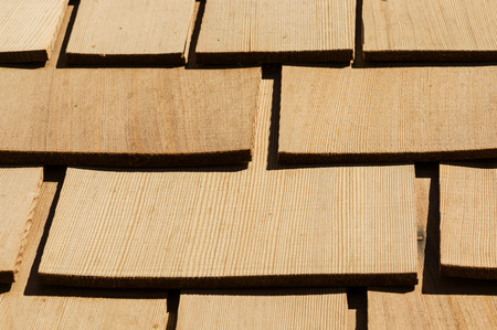 cedar shakes: new wooden cedar roof shingles detail on a roof