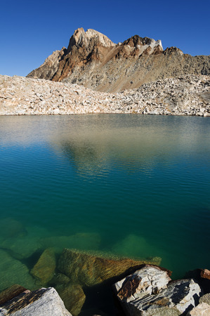mount humphreys: a blue alpine lake with Mount Humphreys in the background