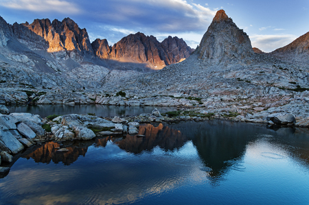 basin mountain: evening reflection of Isosceles and Mount Winchell and Thunderbolt in an alpine lake in Dusy Basin of the Sierra Nevada Mountains