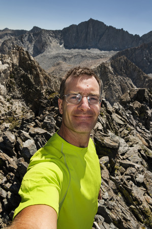 outdoorsman: a man in a Sierra Nevada Mountain top selfie