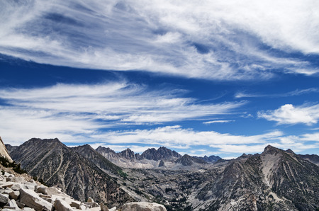feathery: Sierra Nevada Mountain landscape looking over LeConte Canyon to Dusy Basin and the Palisades with feathery clouds