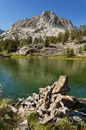 long lake: Hurd Peak looms above Long Lake in the Sierra Nevada Mountains near Bishop California Stock Photo