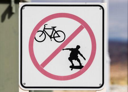 faded no biking or skateboarding sign  photo