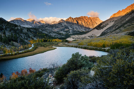 bishop: North Lake in the Sierra Nevada Mountains at sunrise in the fall with yellow aspen trees Stock Photo