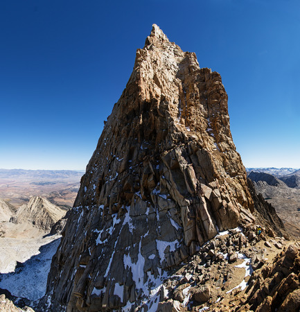 john muir wilderness: Mount Humphreys summit spire in the Sierra Nevada Mountains with two mountaineers at the base Stock Photo