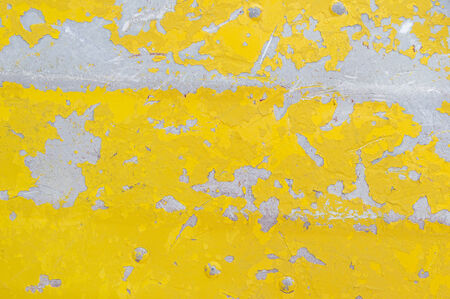 flaked: flaking yellow paint on an old aluminum boat background texture
