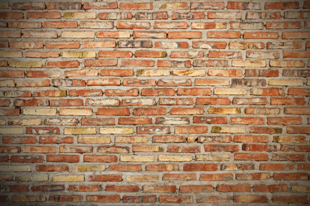 vignette: rough brick wall background texture with vignette