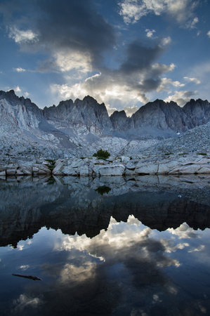 basin mountain: Sierra Nevada mountain lake in Dusy Basin with Palisade Mountains Stock Photo