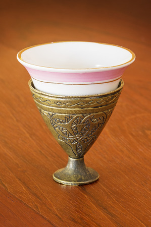 antique Turkish brass zarf with porcelain coffee cup