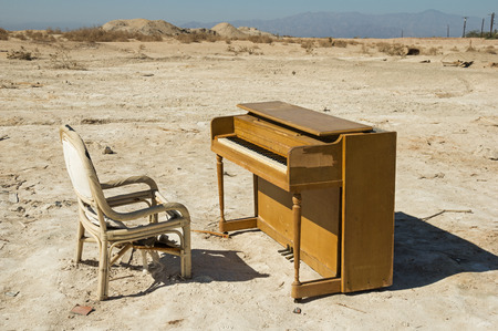 trashed: old abandoned broken piano and chair near the Salton Sea