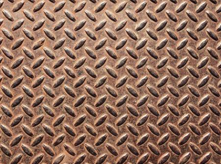 no skid: old rusty and worn diamond tread metal sheet Stock Photo