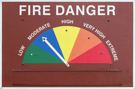 fire danger sign set to moderate or blue
