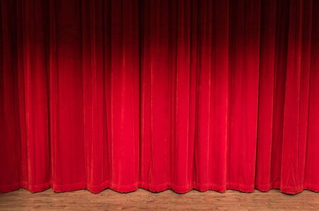 wood stage with closed red curtains with shadow at the top
