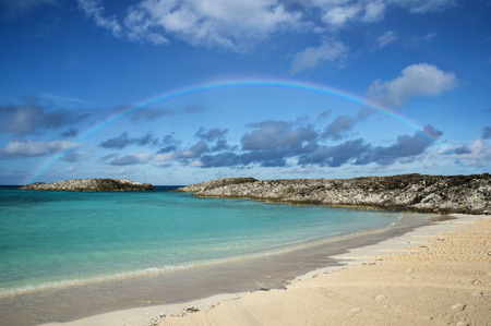 sheltered: rainbow over a sheltered beach in the Bahamas islands