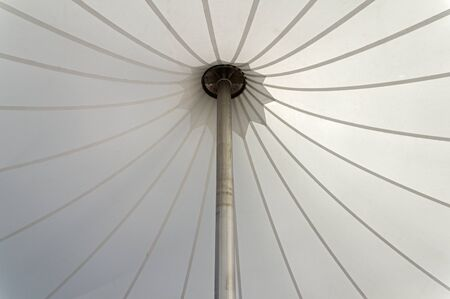white tent canopy supported by an aluminum pole