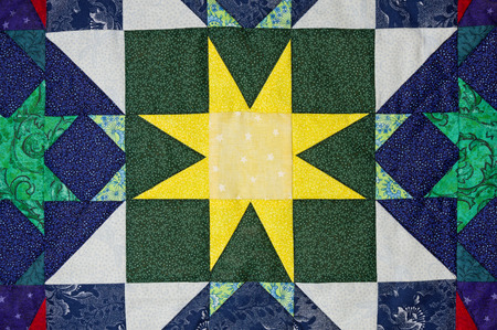 hand made quilt detail with colorful patterned cloth