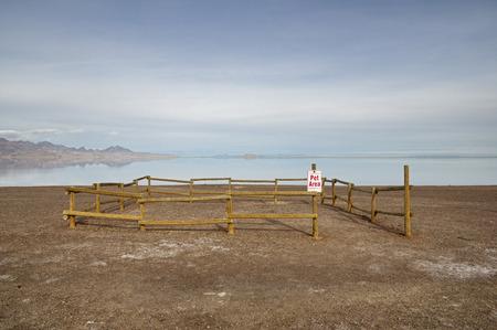 small fenced off gravel pet area near the flooded Bonneville Salt Flats
