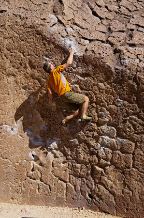 a man bouldering on the volcanic tablelands near Bishop California Stock Photo
