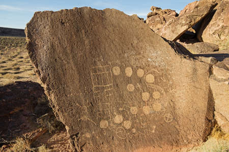 petroglyphs carved into volcanic tuff rock on the volcanic tableland near Bishop California