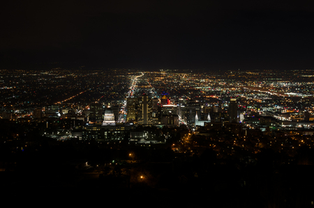 Salt Lake City at night from a nearby hill with city lights