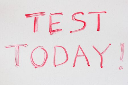 dry erase: test today written on a dry erase white board in red Stock Photo