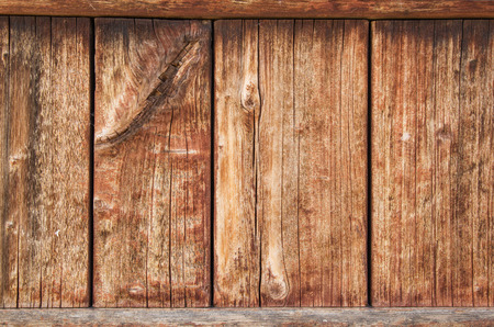 old weathered wood panel with cracking wood grain and fading stain