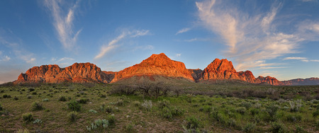 nevada: panorama of the red rocks conservation area near Las Vegas lit up by early morning sunrise light