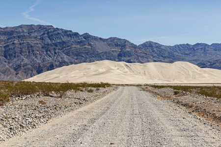 eureka: rocky dirt road leading to Eureka Dunes in Death Valley National Park