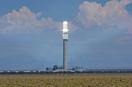 the Crescent Dunes concentrated solar power plant with heliostat mirrors focusing the solar energy onto the central power tower Stock Photo