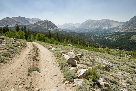 rough road: rocky dirt road above Rock Creek Valley in the Sierra Nevada of California Stock Photo