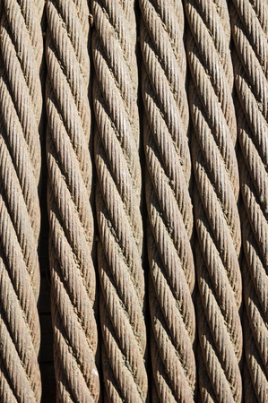 coiled rope: old twisted metal cable rope in a coil Stock Photo