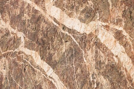 dikes: background detail of the painted wall rock cliff at the Black Canyon of the Gunnison Stock Photo