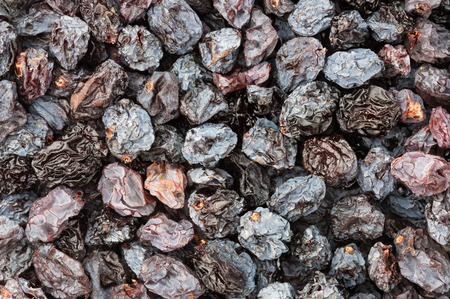 background close up of sun dried raisins Stock Photo